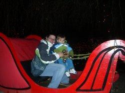Mom and Aidan in Santa's Sleigh