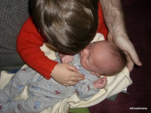 Aidan holding Quinlan