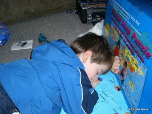 Aidan asleep on the floor.  It is a very comfy map.