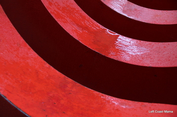 Playing with aperture and the big red coil at Robson Square.