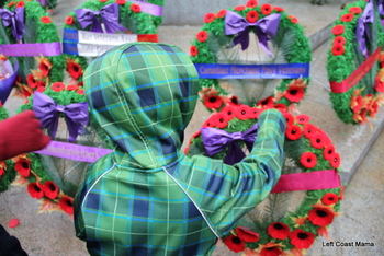 Aidan Laying Our Poppies on the Wreaths.