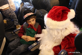 Aidan talking very seriously with Santa.