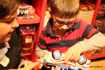 Aidan at the Cars section of the new Disney Store